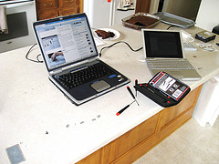 Open laptop beside a choco cake
